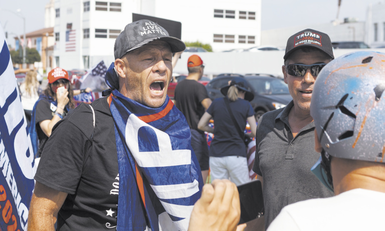 Rally Turns Violent as Extremist Groups Take Part