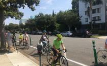 Community Tries Out Protected Roxbury Drive Bike Lane
